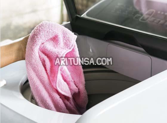 cara membersihkan mesin cuci bukaan atas